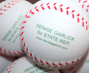 photo of baseballs stamped with Denise Garlick for State Rep