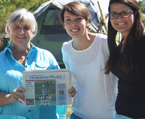 photo of Denise Garlick with staff and newspaper