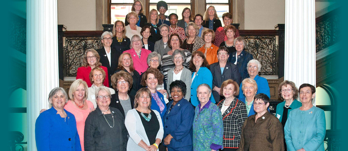 photo of Denise Garlick with women at state house