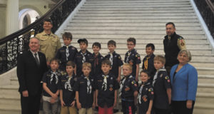 Members of Pack 52, Den 5 pose at the State House with State Representative Denise Garlick and Senator Mike Rush.